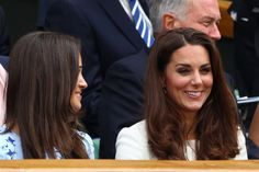 Kate and Pippa have a secret to share as they sit in the Royal Box during Wimbledon 2012: Day Thirteen