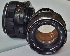 Super-Takumar 55mm f1.8 . A very fine lens both optically and mechanically. This sample is single layer coated. Pentax was the first to use Multi coating. After their success other companies quickly followed.