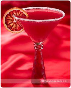 Bloody Valentine Martini (■2 shots Absolute Mandarin Vodka Juice of 3 Blood Oranges (about 1 cup) Splash of Campari 2 Slices of Blood Orange, for garnish White Sugar, to rim the glass)