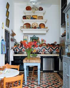 Lovely bohemian kitchenette. Not sure, but looks like the flooring is Andalusian... #kitchen #home #color #fusion #eclectic #decor