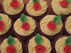 Valentine's red velvet cupcakes with vanilla buttercream and fondant roses by Sunflower Cake Company.