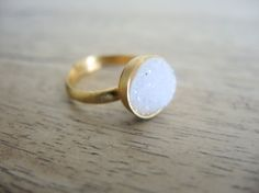Amazing Druzy ring with 10mm round with a high 18K gold vermeil matte/polished bezel set coated with rhodium to be of a high standing quality. The color of the druzy is natural white rainbow, elegant and wonderfully cute !  I look for beautiful stones, as its like a treasure hunt ! With these druzy stones with a backing coated with high quality titanium to draw out a brilliant and beautiful mystic white rainbow, I believe we have found gold at the end of the rainbow ! This jewelry is uni...