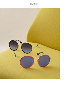 GUCCI Metal and acetate round pilot sunglasses with endura gold frame, green and red front and green lenses. $485. Metal and acetate pilot aviator sunglasses with fuchsia glitter rim and blue lenses. $485.