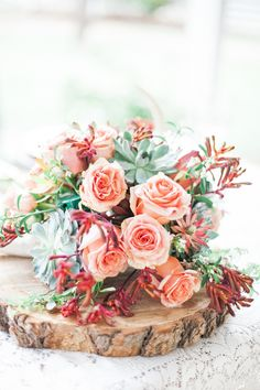 Beautiful rustic floral centerpiece perfect for a fall woodland wedding.