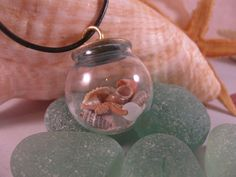 Sea Lovers Globe of Treasures Necklace by SignsCapeCodDesigns, $35.00