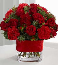 Christmas Centerpiece - Carnations & Assorted Holiday Greens