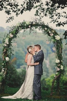 vintage green and white wedding arch with flower decorations