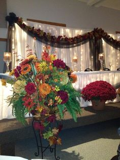 Large alter bouquets to enhance the bridal table.