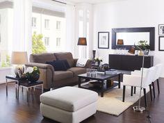Large horizontally hung mirror. TIDAFORS sofa. HEMNES coffee table. ÅDUM rug. NILS armchairs. MONGSTAD mirror. NYFORS floor lamp.