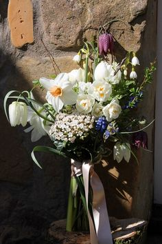 Soft spring bouquet of narcissi muscari and snake's head fritillary from www.bluepoppyflorist.com