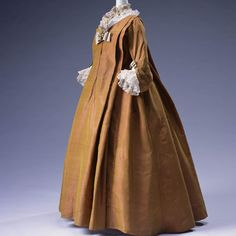 The Kyoto Costume Institute's 1720 Robe Volante dress is a loose fitting garment made with silk taffeta and is pleated on the front and back.