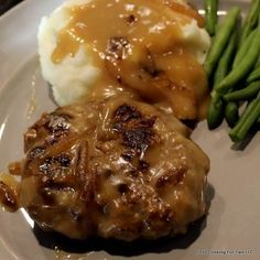 Old Fashion Salisbury Steak with Onion Gravy It's time for some great comfort food. This old fashion Salisbury Steak with onion gravy will bring back memories and will become a weeknight favorite. Meat Recipes, Cooking Recipes, Hamburger Recipes, Cooking Games, Casserole Recipes, Chopped Steak Recipes, Hamburger Dishes, Cooking Pasta, Polish Recipes