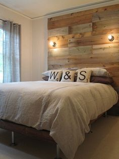 right down to the Scrabble pillows =) industrial light fixtures, DIY reclaimed wood headboard & scrabble pillow accents Reclaimed Wood Headboard, Pallet Headboards, Wall Headboard, Headboard Lights, Queen Headboard, Home Bedroom, Bedroom Decor, Sweet Home, Diy Casa
