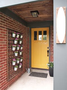 For a small porch, try a vertical planter. 39 Budget Curb Appeal Ideas That Will Totally Change Your Home Small Front Porches, Small Patio, Small Terrace, House With Porch, House Front, Pallet Ceiling, Porch Ceiling, Porch Wall, Plank Ceiling