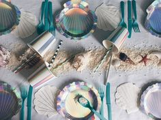 Our Mermaid party theme tableware comes as a complete set of cups, straws, plates, and napkins. The straws are in beautiful sea inspired shades of blues and greens and the shimmering holographic foil looks pretty magical when the light catches it ... I think budding Mermaids and Mermen will love it.  The MERMAID table set includes • 16 scalloped shell Napkins 125mm x 125mm by Meri Meri • 8 scalloped shell Plates 185mm x 185mm by Meri Meri • 8 Holographic stripe cups 9oz by Meri Meri • 24…