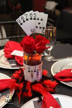 Straight Flush centerpiece with red roses for a casino themed party.
