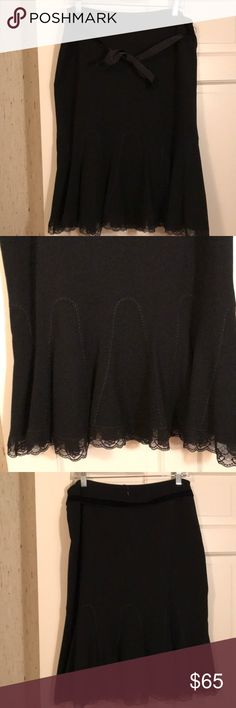 """Elie Tahari trumpet style skirt w/lace hem Elie Tahari trumpet style skirt with lace hem and velvet sash.  EUC. No damages excellent condition. Length is 26"""".  Size 12 color black. No low offers. Price firm.   DISCLAIMER: You buy it, you keep it! If you are a habitual returner, do not buy from my closet. I am not responsible for you changing your mind about your purchase if you don't like what you received, or the size or color isn't right. Don't open a case. Elie Tahari Skirts Midi"""