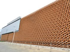 A sophisticated joining system that relies strictly on carved wood and no metal couplers holds the grid together. Called living construction, this design technique helps to render a building more resistant to major earth movements, which are common in Japan.