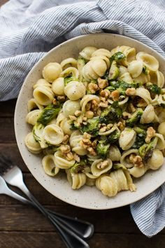 A quick and simple roasted Brussels sprout pasta that is tossed with a lemon cream sauce and topped with toasted walnuts.
