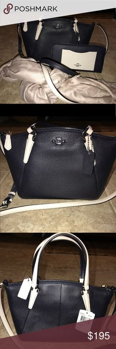 Coach midnight dark navy crossbody purse Coach dark navy blue crossbody with off white accents. New with tags. Never used. Coach Bags Crossbody Bags