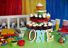 Baby boy first birthday party. Love the frame in the back. Good picture idea. Like the set up