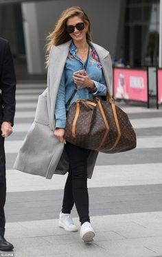 Delta Goodrem jets into Adelaide wearing tight jeans with designer bag