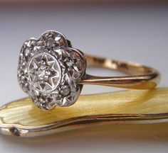Vintage Engagement Ring. Cushion Cut & Rose Cut Diamonds. Cluster Daisy Design. 9K Gold and Platinum. For sale at Sweet Heirloom Vintage. Via Diamonds in the Library.
