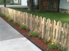 pallet fence - perfect for the front yard eventually!
