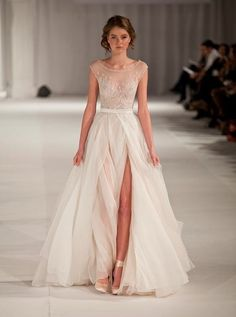 Trade the statement jewelry for an  embellished necklines, like this gown by Paolo Sebastian. Don't miss the ballerina-inspired shoes.