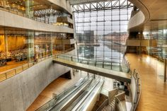 Copenhagen The central atrium opens the library up to the city and water, softening the edifice's powerful stature. A majority of the public functions are located here at the core of the building, which is intended to serve as a public gathering space, while deeper interior spaces offer more insulated rooms for study.