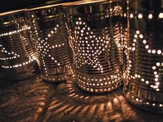 Tin can lanterns turns what many of us think of as rubbish into something useful and beautiful! How to make tin can lanterns. Tin Can Lights, Tin Can Lanterns, Tin Can Art, Garden Party Decorations, Wedding Decorations, Tin Can Crafts, Party Lights, Diy Solar, How To Make Diy