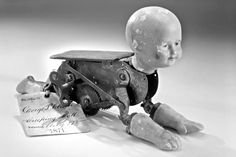 """Model for a""""Creeping Baby Doll,""""which was patented in 1871; Wax head and crawling motion powered by an internal clockwork mechanism."""
