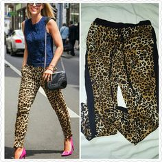 Leopard Print  Pants Leopard Print  Pants Very versatile,  l've dressed them up and down!  No defects!  Elastic waist band with tie and black satin track the side. fashion web Pants