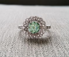"Halo Blue Green Moissanite Diamond Ballerina Antique Engagement Ring Gemstone Flower Filigree Mint Aqua Round 14K White Gold ""The Mae"" by PenelliBelle on Etsy"