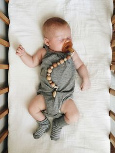 Wooden pacifier clip to keep your little ones paci right where you need it. The clip is wood and has rubber ends to keep your littles clothes safe....