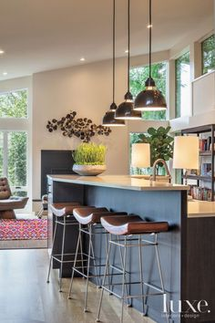 Contemporary White Kitchen with Slanted Ceiling