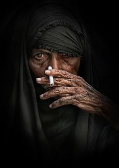Old face, hand, aged, intense eye, powerful, strong, cigarette, portrait, photo