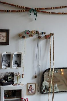 A way to infuse mama's love of sewing into the nursery?  Vintage thread spool hooks...I think this is a done deal!