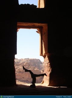 """Yoga Poses Around the World: """"This shot was taken from inside the ruins of Petra, I did Sirsasana in the doorway and you can see the Rose Red City of Petra outside. (Petra is in Jordan and where the famous Indiana Jones scenery was shot.) :)"""""""