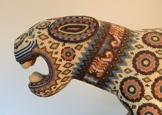 Wood jaguar made by a Huichol artist in Jalisco Mexico by placing tiny glass beads on a beeswax coating. Photo by Karen Elwell
