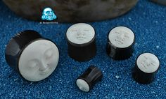 Black horn plugs with carved bone moon face