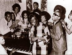 Vintage Motown: A jam session from the 1960s features Kim Weston (microphone) Stevie Wonder(dark glasses), Berry Gordy Jr. at the piano, Smokey Robinson (center rear) and Marv Johnson, at Gordy's left.