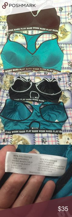 Bundle of 2 work hard sports bras 2 super cute work hard play hard sports bras, by Love Affair. One is a teal color the other is black. The teal is in great like-new condition and the black has been gently used, in the last picture you can see a little tear at the top of the seam on the left breast. It is only torn on the top layer of fabric and can easily be stitched shut if it bothers you. Both are 40DD and no wires! Love affair Intimates & Sleepwear Bras