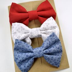 www.asimplebow.etsy.com Fabric hair bow for girls, women, or teens in red, white floral, and blue floral print. Theyre great for everyday wear or as a cute gift. Please note