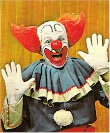Bozo the Clown scared the crap out of me!  I still don't like clowns!