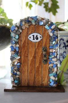 Miniature Wood Fairy Hobbit Door with Blue Shells by TheFabledDoor, $15.00...not in my budget, but great design for DIY inspiration....