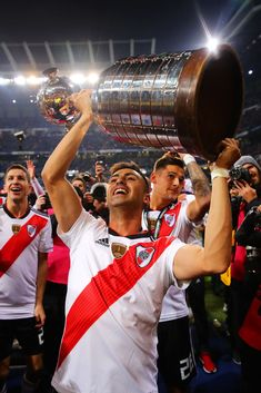 MADRID, SPAIN - DECEMBER 09: Gonzalo Martinez celebrates with the trophy following the second leg of the final match of Copa CONMEBOL Libertadores 2018 between Boca Juniors and River Plate at Estadio Santiago Bernabeu on December 9, 2018 in Madrid, Spain. Due to the violent episodes of November 24th at River Plate stadium, CONMEBOL rescheduled the game and moved it out of Americas for the first time in history. (Photo by Chris Brunskill/Fantasista/Getty Images)
