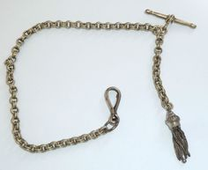 A VICTORIAN SILVER TONE ALBERTINA WATCH CHAIN WITH TASSEL