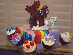 My Little Pony cake.  Princess Luna on top, cupcakes representing all other ponies.  All decorations are modeling chocolate.