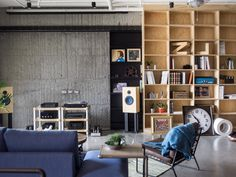 HAO Design Studio designed this modern/industrial apartment in Kaohsiung City, Taiwan for a couple, their three beloved cats, and all of their collectibles.